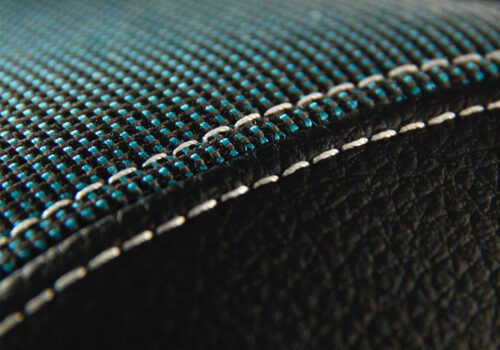 Edge of car seat with coated upholstery