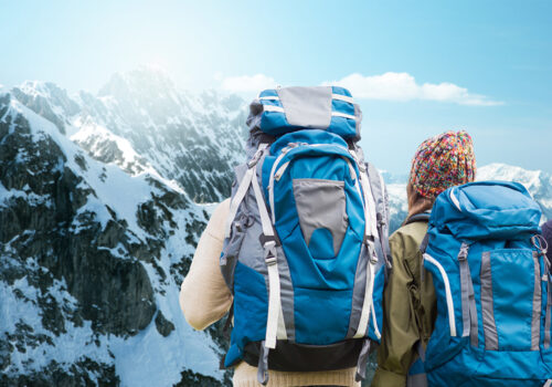 Backpacks and outdoorwear in mountain setting