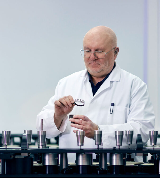 Peter Goodwin, textile testing expert with martindale pilling and abrasion tester