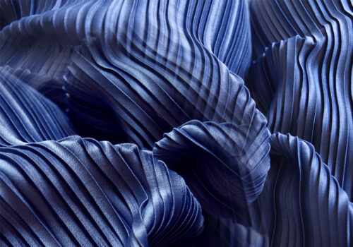 dark blue pleated fabric, which can be tested on dynawash garment and printed fabric durability tester