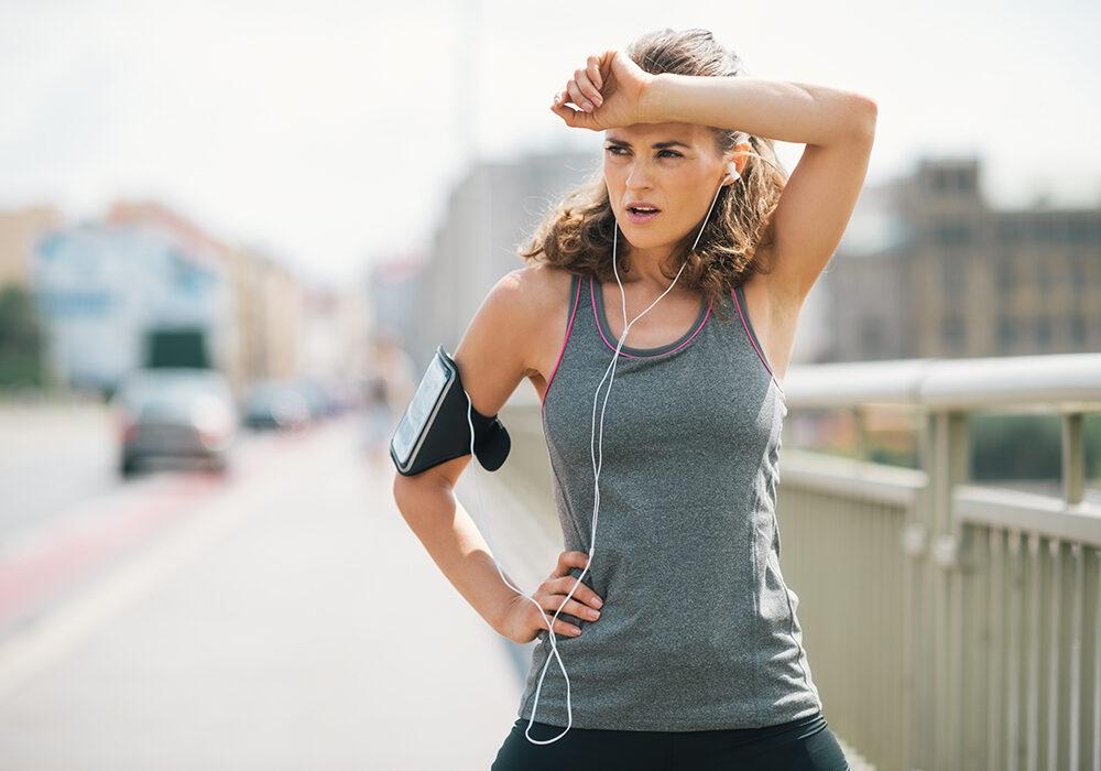 Woman on run over bridge in sportswear