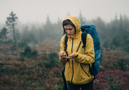 Woman in rain in raincoat outdoorwear application