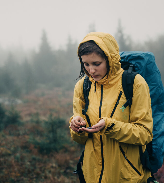 Woman in rain in yellow jacket - application for testing in AquAbrasion