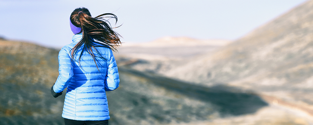 Woman jogging with down jacket performance testing