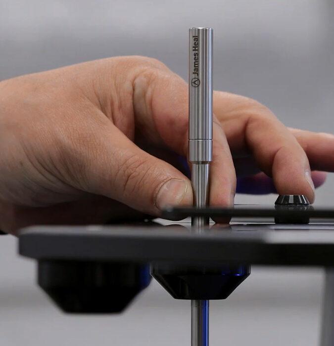 James Heal calibrating textile testing equipment