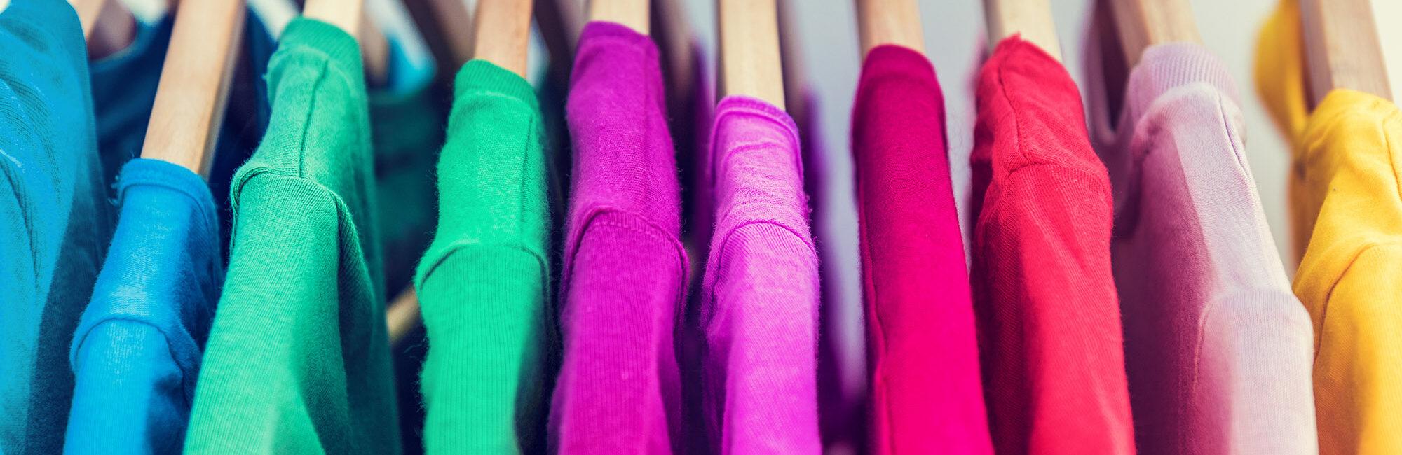 multi coloured tshirts on hangers