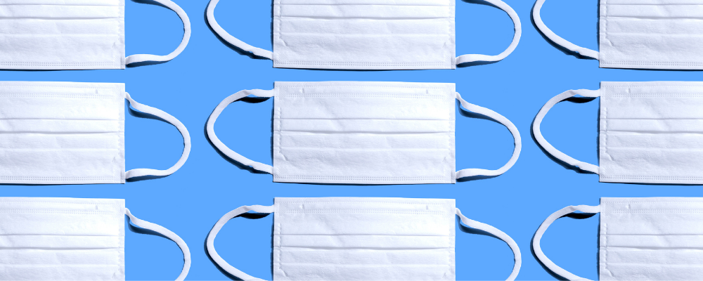 white face masks personal protective equipment ppe on a blue background