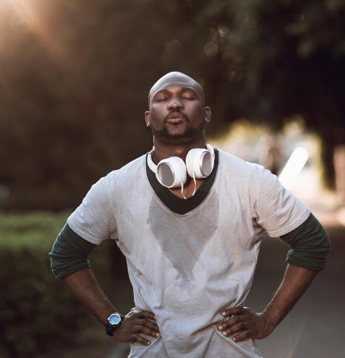 man sweaty after a run, sweat wicking through his tshirt