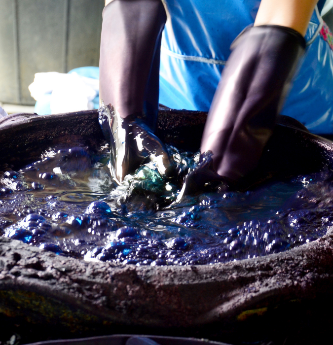 textile being dyed with blue chemicals