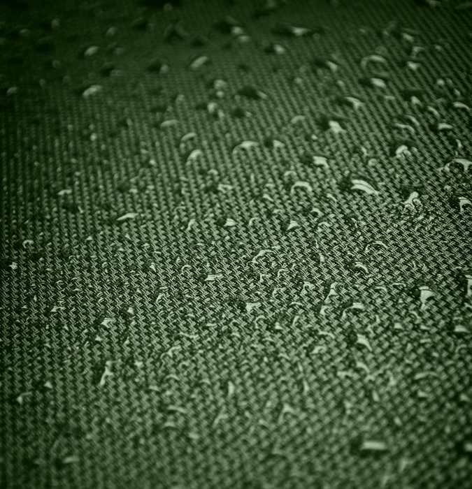 green fabric with moisture on top, a visual representation of wicking