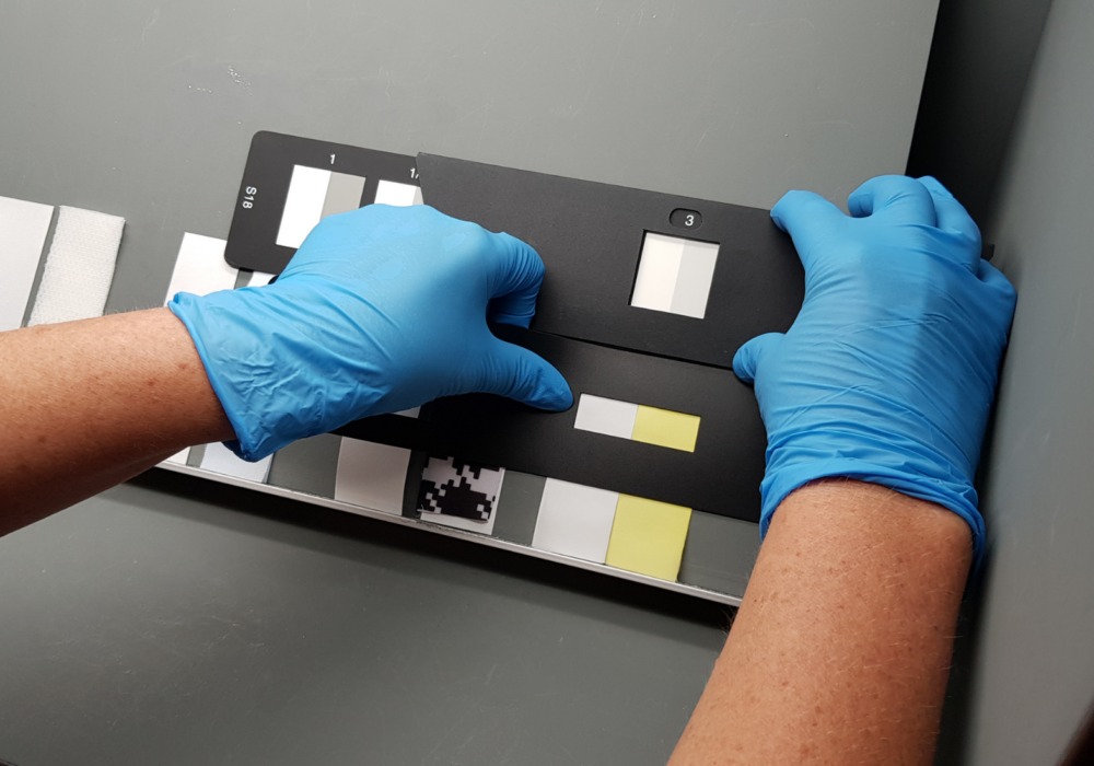 phenolic yellowing samples being graded in a light box